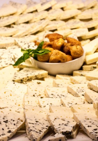 A tray of blue cheese wedges at a salad bar