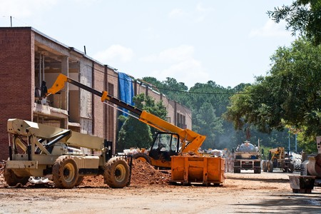 construction machinery: A construction project at an old brick school Stock Photo