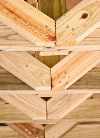 Roof trusses of pine two by fours photo