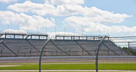 An automobile racetrack between a fence and stands Stock Photo