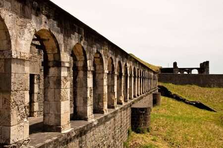 stone arches: A line of old stone arches on a hilltop fortress Stock Photo