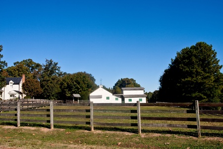 outbuilding: Barn and outbuilding at a small farm past fence
