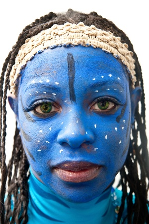 A woman wearing an avatar costume with blue face paint Фото со стока