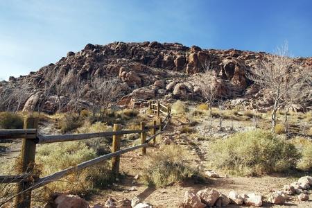 split rail: A split rail fence running across the desert toward distant mountains