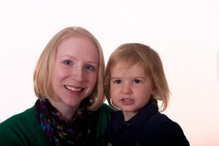 A young woman and a baby on white background photo