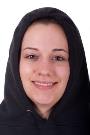A young brunette wearing a black hoodie smiling