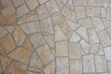 A patio of flat stones and mortar for background and texture 스톡 콘텐츠