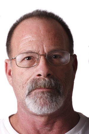An older guy with grey beard and mustache wearing glasses looking straight at camera