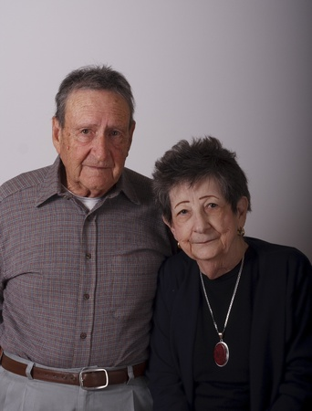 An older couple on a gray background Banco de Imagens