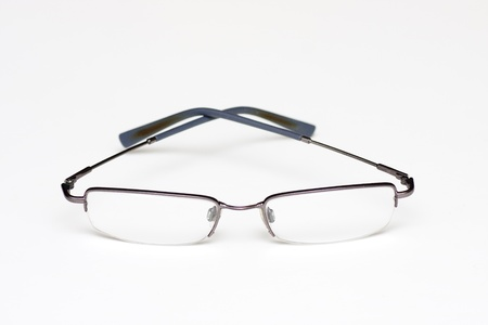 A pair of wire rimmed reading glasses on white Zdjęcie Seryjne