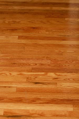 A highly polished hardwood floor in a home photo