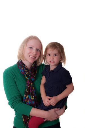 A young blonde woman holding a blonde baby in blue shirt photo