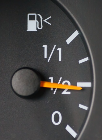 A gas guage in a car showing half full or half empty Standard-Bild