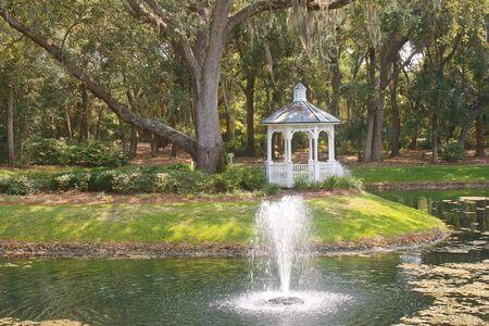 gazebo: Fountain in Lake by White Gazebo