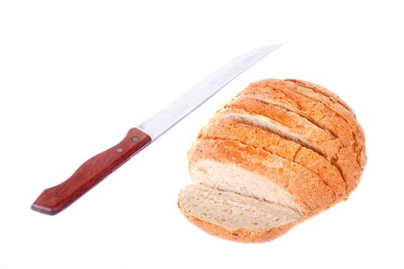 A loaf of sliced whole grain bread on a white background with bread knife