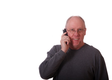 An older man getting good news talking on the telephone photo