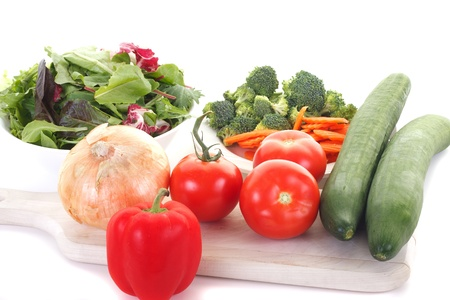 Ingredients for a fresh green salad on a wood cutting board Stock Photo