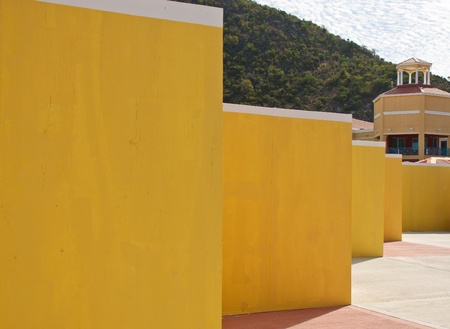 A line of yellow stucc walls into the distance Stock Photo - 10449874