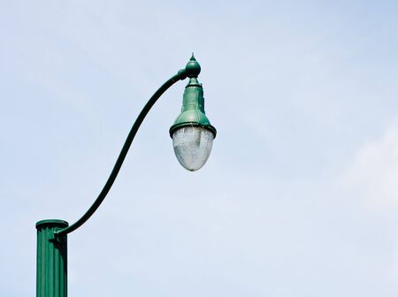 An old fashioned green lamp post against the sky Stock Photo - 10449873