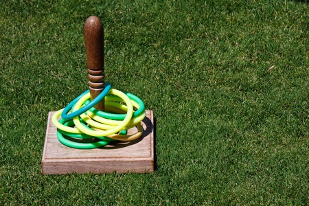 to toss: A classic game of ring toss on a green lawn Stock Photo