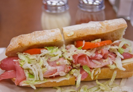 A fresh italian sub sandwich of cold cuts, cheese, lettuce and tomato