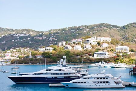 Giant luxury yachts at a tropical pier Stock Photo - 10850391