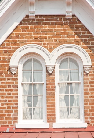 A traditional brick dormer with two wood frame windows Stock Photo - 10888935