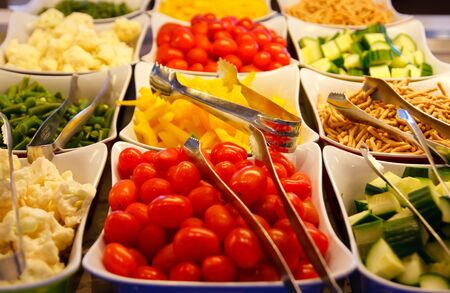 Many colorful vegetables on a salad bar photo