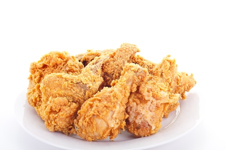A white plate of fresh, hot, juicy fried chicken photo