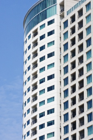 A high rise condo tower against a clear blue sky photo