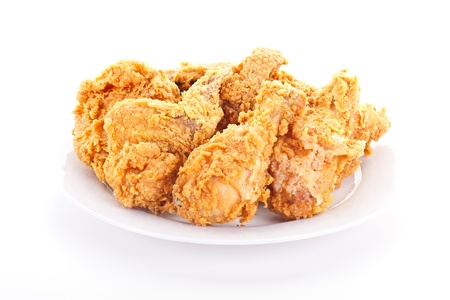 A plate of fresh, fried, crispy chicken on a white plate on a white table photo