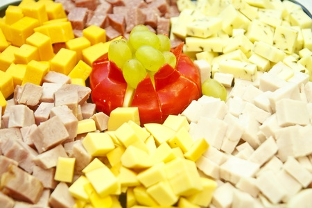 cubed: A party tray of cubed cheeses with gouda and grapes in center