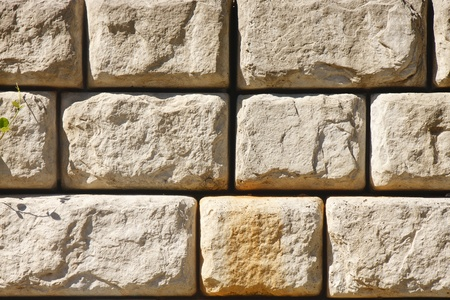 retaining: An old stone block retaining wall for background or textures Stock Photo