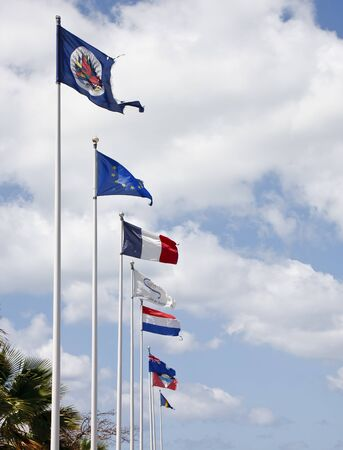 Flags from many countries against a nice summer sky