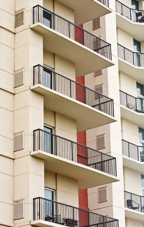 Balconies on a luxury condo building with black wrought iron railings Banque d'images