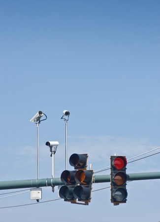 Traffic lights and enforcement cameras at a city intersection photo