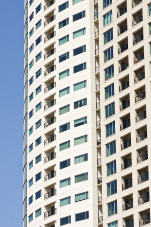 A condo tower with balconies on a blue sky Stock Photo - 12383040