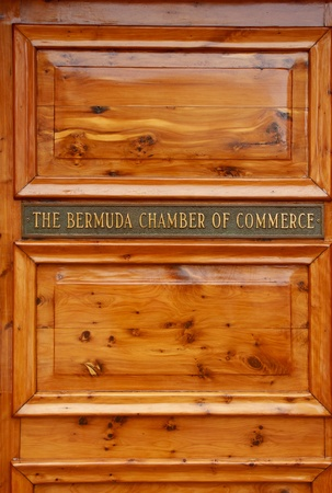 Door with plaque showing the Bermuda Chamber of Commerce in Hamilton, Bermuda