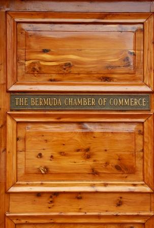 commerce: Door with plaque showing the Bermuda Chamber of Commerce in Hamilton, Bermuda