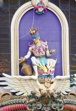 carnivale: A mardi gras display on a wall with colorful characters