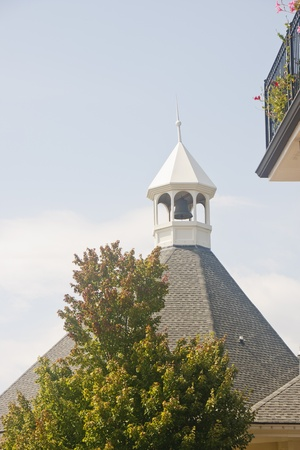 A classic old bell tower in a town square