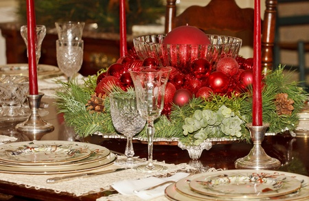 A formal dining table decorated for a Christmas dinner photo
