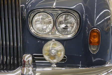 A classic old blue limousine headlights and chrome