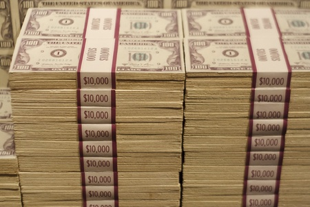 Stacks of Hundred Dollar Bills Banded in Ten Thousand Dollar Packets