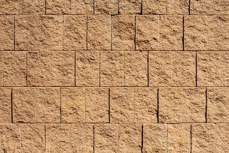 retaining: A brown block retaining wall for backgrounds or textures Stock Photo