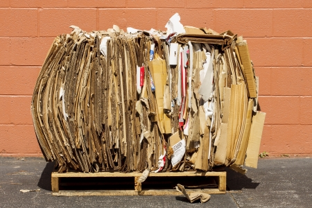 Bundle of cardboard crushed and packed for recycling photo