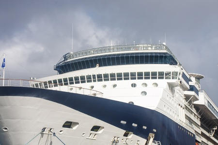 ship bow: The bow and bridge of a large blue and white luxury cruise ship