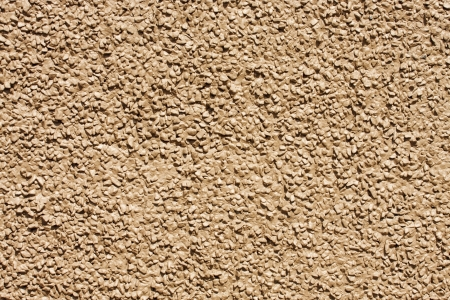 wall textures: A wall of stone aggregate painted brown for background and textures