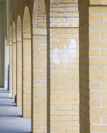 distance: Arches in yellow brick disappearing into distance Stock Photo