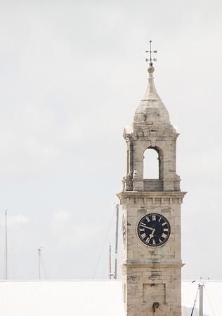 clocktower: An old clocktower rising into the sky over the Naval Dockyard in Bermuda